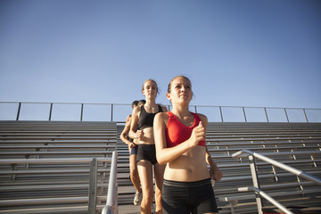 Teenage runners training on stadium bleachers
