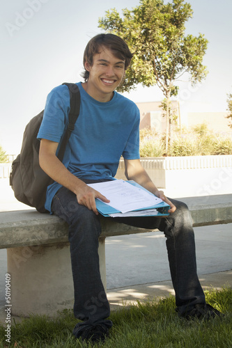 Caucasian man sitting on high school campus