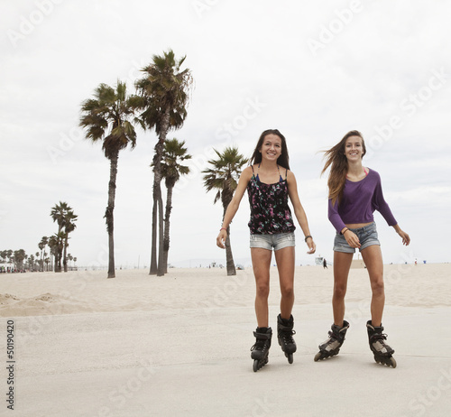 Friends roller blading at beach
