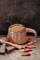 Mexican hot chocolate with cinnamon sticks and chilis