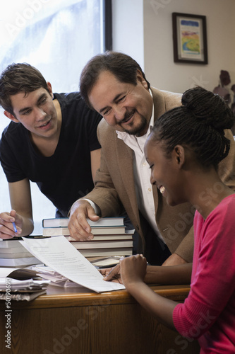 Teacher and co-workers looking at paperwork