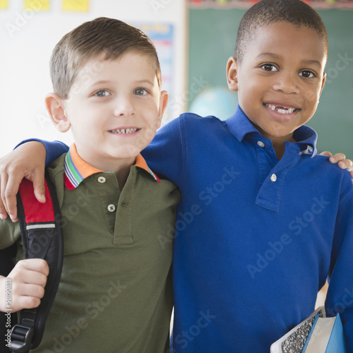Boys hugging in classroom