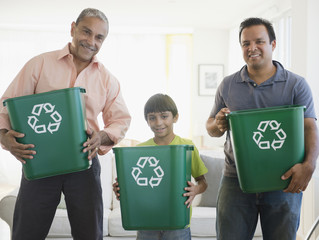 Hispanic grandfather, father and son recycling