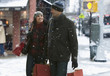 Couple shopping together in the snow