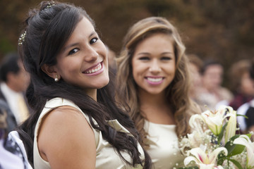Smiling Hispanic girl at wedding