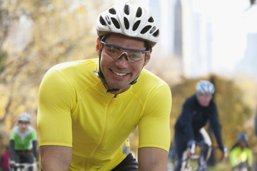 Mixed race man in bicycle race