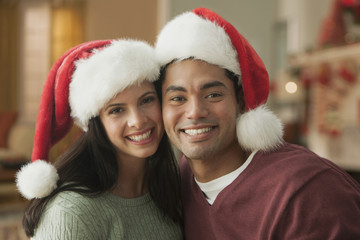 Smiling couple in Santa hats