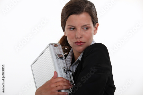 Businesswoman protecting briefcase