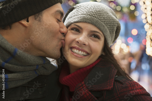Mixed race man kissing girlfriend
