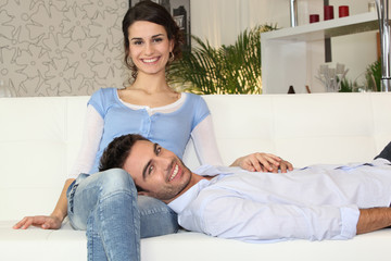 Happy couple on a sofa