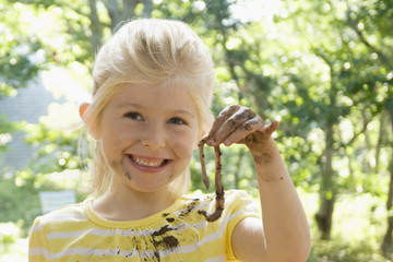 Caucasian girl holding worm