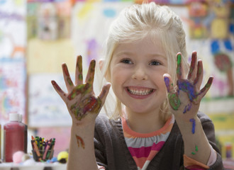 Caucasian girl with paint on hands