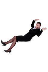 Businesswoman falling backwards