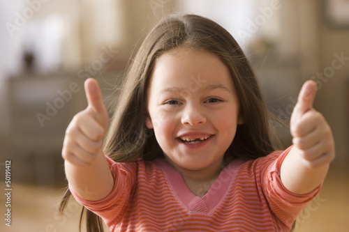 Caucasian girl giving a thumb's up
