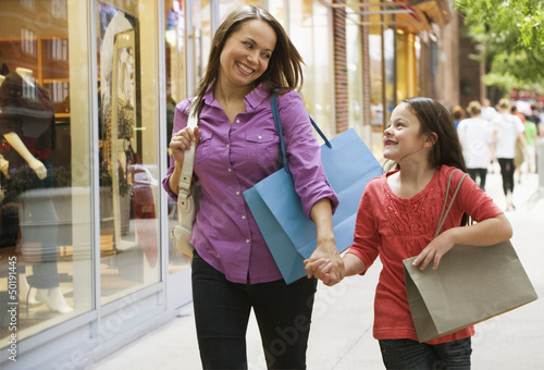 Caucasian mother and daughter shopping together