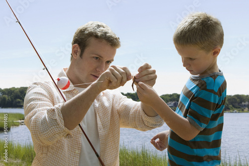Caucasian father and son fishing