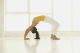 Hispanic woman doing backbend