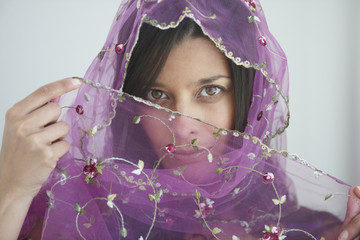 Hispanic woman in glamorous scarf