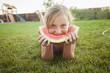 Caucasian girl eating watermelon