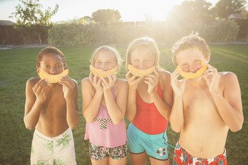 Children eating cantaloupe