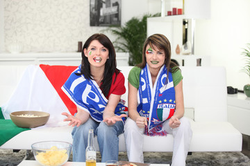 Two women about to watch Italy play football