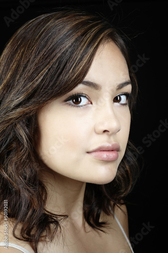 Serious mixed race woman