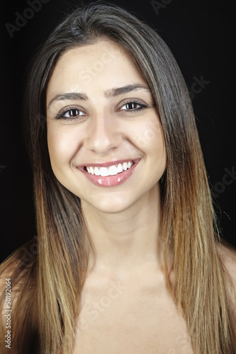 Smiling mixed race teenager