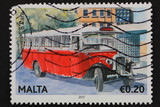 Malta: circa 2011:stamp shows image of classic red Maltese bus