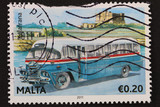 Malta: circa 2011: stamp shows image of classic blue Maltese bus