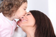 Girl kissing her mother