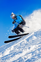 Man Skiing Against Blue Sky