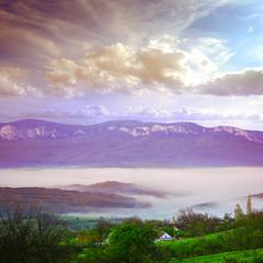 mountians village under fog