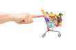 Finger pushing a shopping cart full of food products
