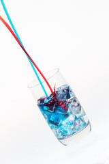 Blue and red stream mixing in a highball