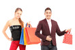 Young man and woman holding shopping bags