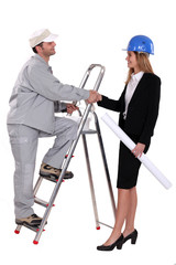 Decorator and designer shaking hands
