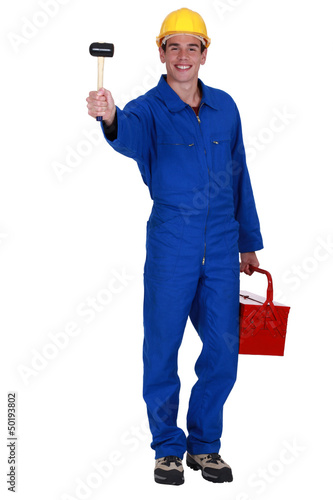 Man holding mallet and tool kit