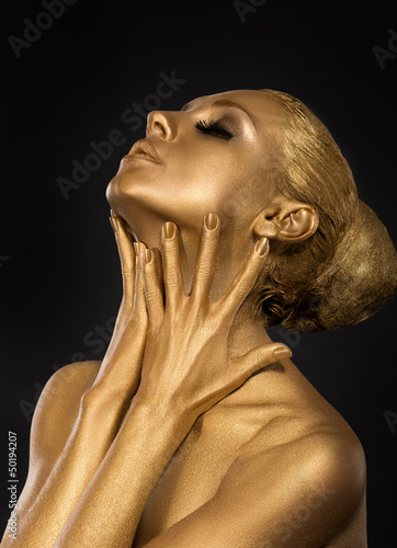 Coloring. Gilt. Golden Woman's Face. Art concept. Gilded Body
