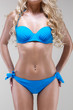 slim model in blue bikini, studio shot