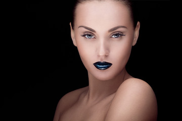 close up portrait of model with stylish makeup, over black
