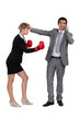 man on the phone and woman with boxing gloves