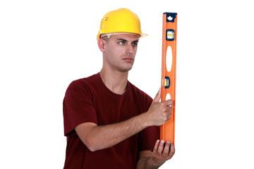 craftsman holding a level