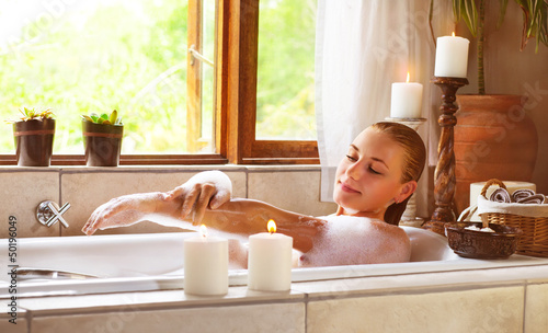 Sensual woman in bathtub