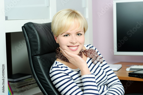 cheerful girl in office