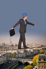 Businessman walking on a tightrope
