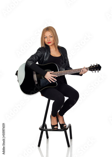 Sexy guitarist sitting with a black leather jacket