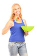 Mature smiling woman eating a salad