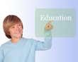 Happy preteen boy pointing the word Education