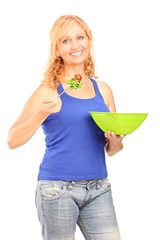 Mature smiling woman eating a salad