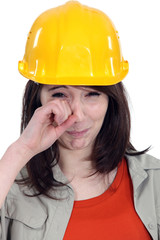 Brunette builder crying